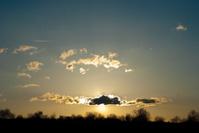 sunset behind a cloud