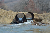 Dam with pipes