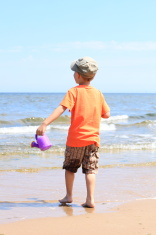 boy playing toys on beach