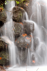 Water cascades down rocks.