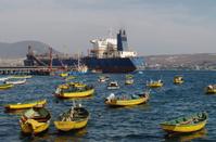 Fishing boats and cargo ship in Guayacan harbor