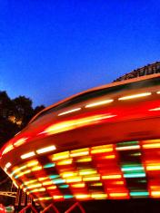 Spinning carnival ride at night