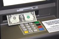 ATM dispensing Cash
