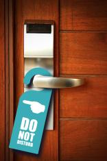Do not disturb sign hang on door knob