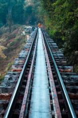 Monk walking on the railroad