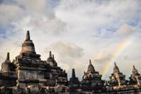 Rainbow over Stupa Buddist temple Borobudur complex in Yogjakart