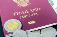 Thailand passport and thai bath.