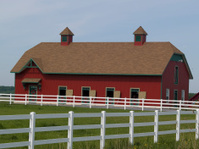 Red Horse Barn with White Fence