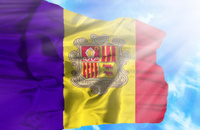 Andorra waving flag against blue sky with sunrays