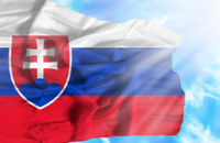 Slovakia waving flag against blue sky with sunrays