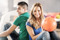 Young couple at bowling alley.