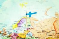 Finnish flag pinpoints Helsinki, Finland, on European map