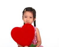 Little asian girl hold the heart