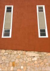wall with bricks and windows