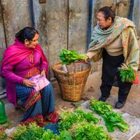 Lady selling vegetables on street in Kathmandu, Nepal