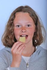 Girl eating chip