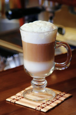 Hot chocolate with milk cream in cafe