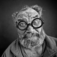 Crazy man with glasses