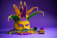 Mardi Gras or Carnivale mask on a purple background