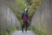 Alternative Model stood on a bridge