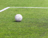 Old ball on soccer field