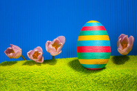 Decorated egg and tulips - symbols of Easter.