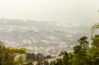 Pollution over a capital city - Caracas Valley