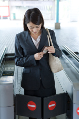 Business woman stopped by ticket gate of station