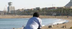 Barcelona beach, man thinking