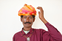 Thirty year old Asian man in colorful turban