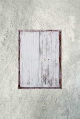 Wooden window on old plaster wall