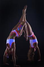 Sexy slim girls with UV makeup dancing in studio
