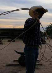 teacher cowboy roping sunset silhouette