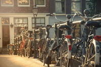 Bicyles against a bridge guardrail in Amsterdam, Netherlands
