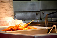 Tray of corn dogs under a heat lamp