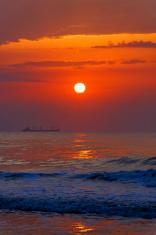Orange Sunrise with Ship