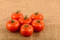 tomatoes on burlap background