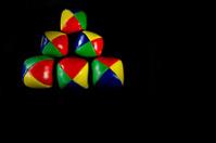 Pyramid juggling balls on a black background