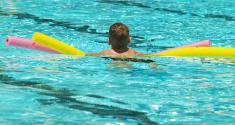 boy using floats in pool