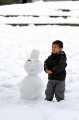 Boy and a snowman