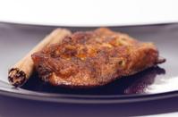 Torrija on a black plate.