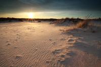 sunset over sand dunes