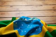 Brazilian flag on wooden background