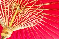 Thailand, Chiang Mai, hand painted red Thai umbrellas .