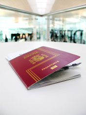 Passport and boarding pass, waiting in a modern airport