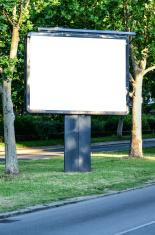 Empty billboard in beautiful landscape next to the road