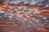 Glowing dramatic cloudscape at sunrise or sunset