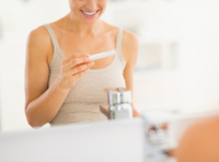 closeup on happy young woman with pregnancy test