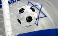 Flag of Israel and soccer ball in goal net