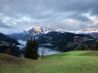 Cloudy sunrise over Dolomites mountains